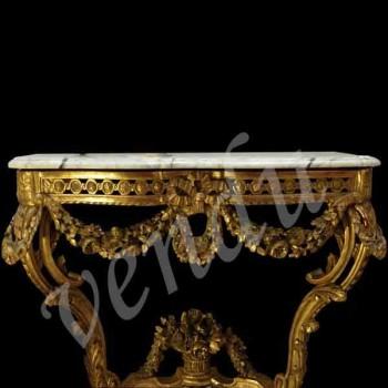 Consola de madera dorada tallada Louis XVI
