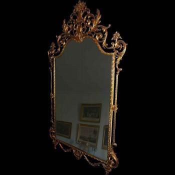 Espejo estilo Luis XVI en bronce dorado del siglo XIX.
