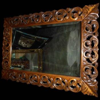 Espejo barroco en madera tallada del siglo XIX.