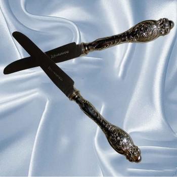 Copertina-coltelli in argento vecchio