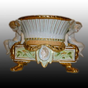 Putti planter in fine porcelain marked with two R.B.