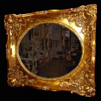 Espejo en madera y estuco dorado de finales del siglo XIX.